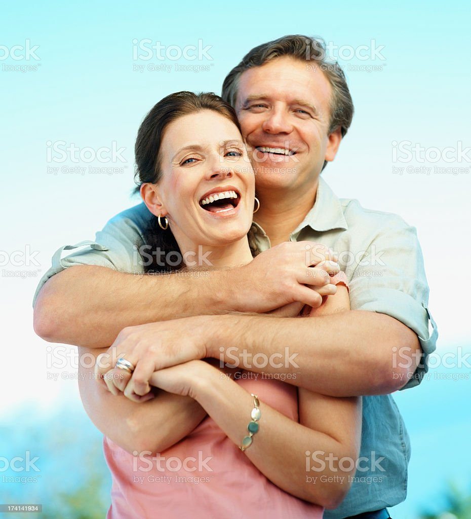 Mature couple having a good time while embracing eachother stock photo