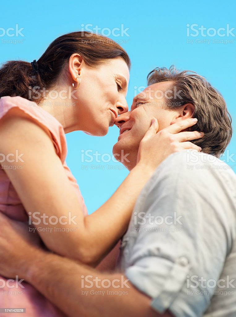 Mature couple having a romantic time together stock photo