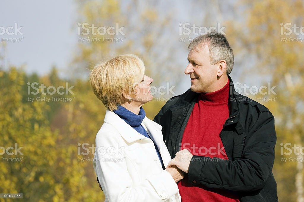 Mature couple having a walk royalty-free stock photo