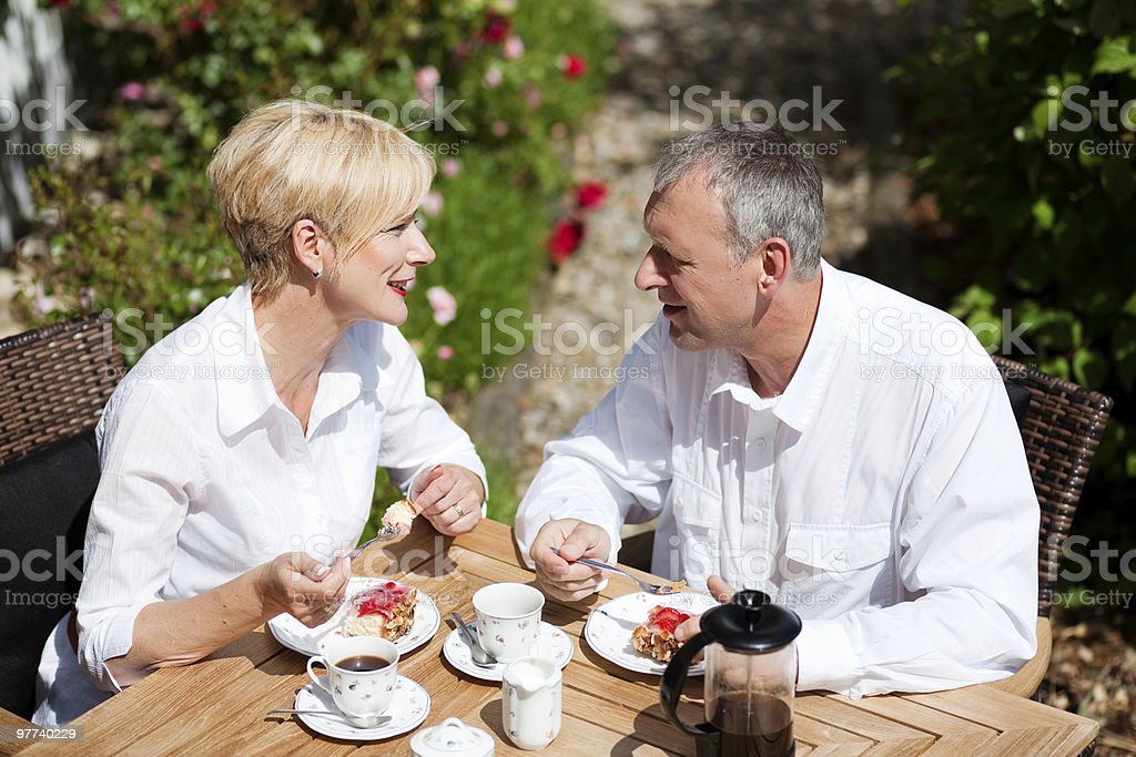 Mature couple having coffee on porch royalty-free stock photo