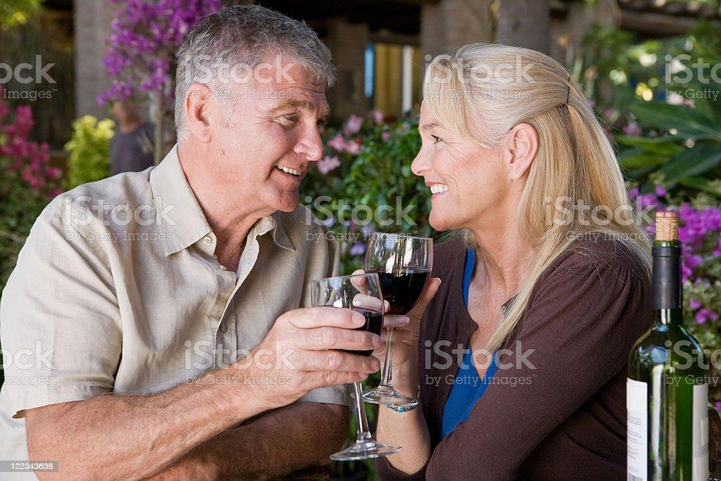 Mature couple having red wine stock photo