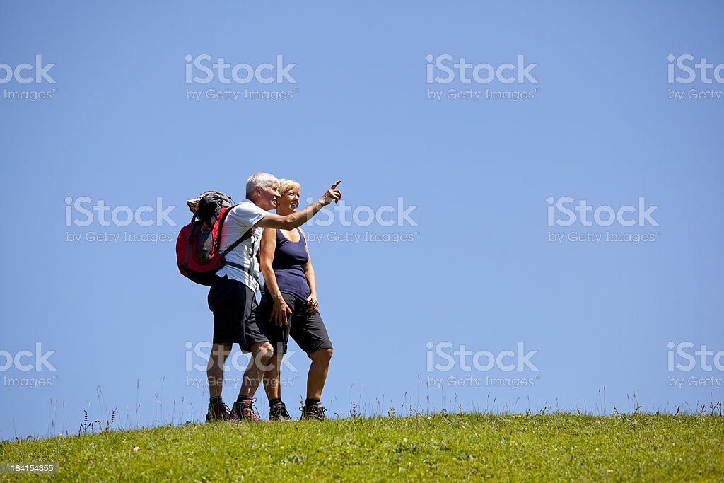 Mature couple hiking royalty-free stock photo