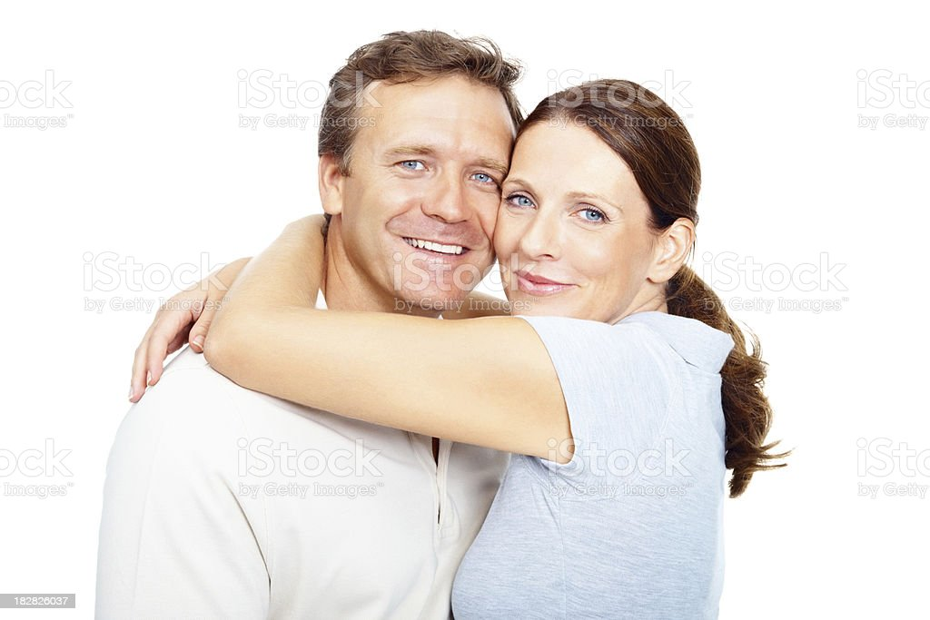 Mature couple hugging against white background royalty-free stock photo
