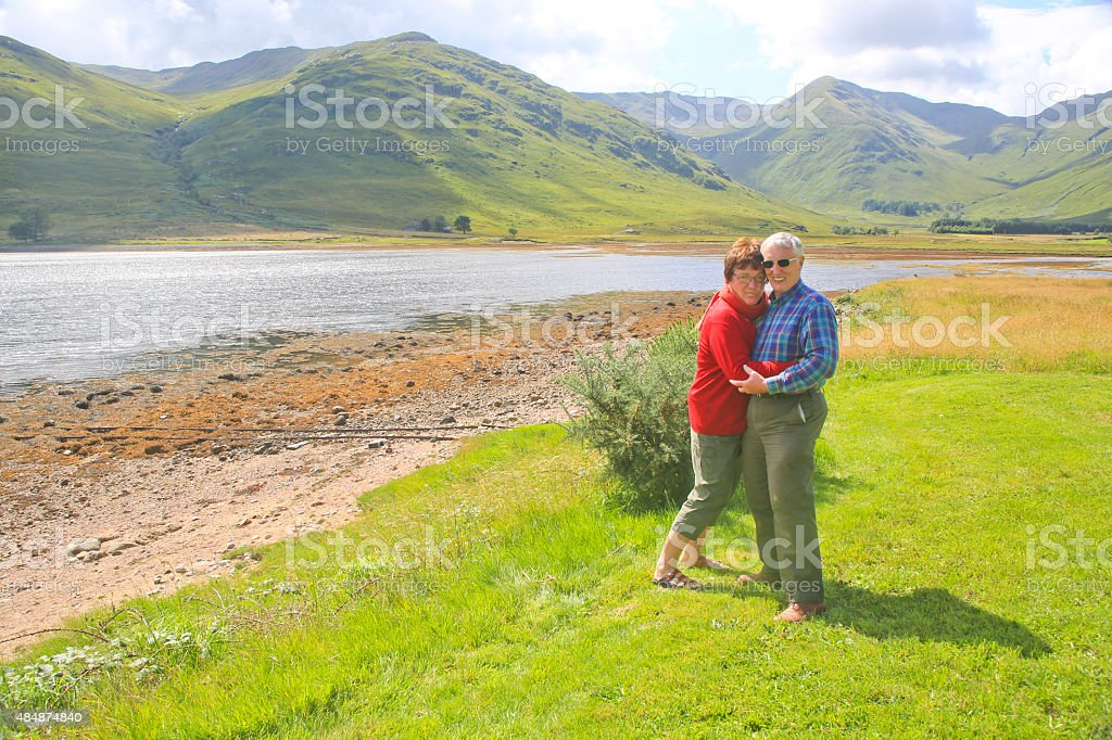 Mature Couple Hugging in Highlands of Scotland stock photo