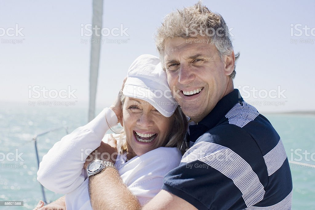 Mature couple hugging on boat royalty-free stock photo