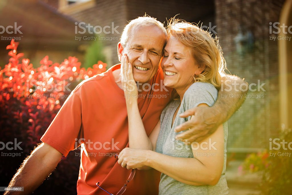 Mature Couple Hugging stock photo