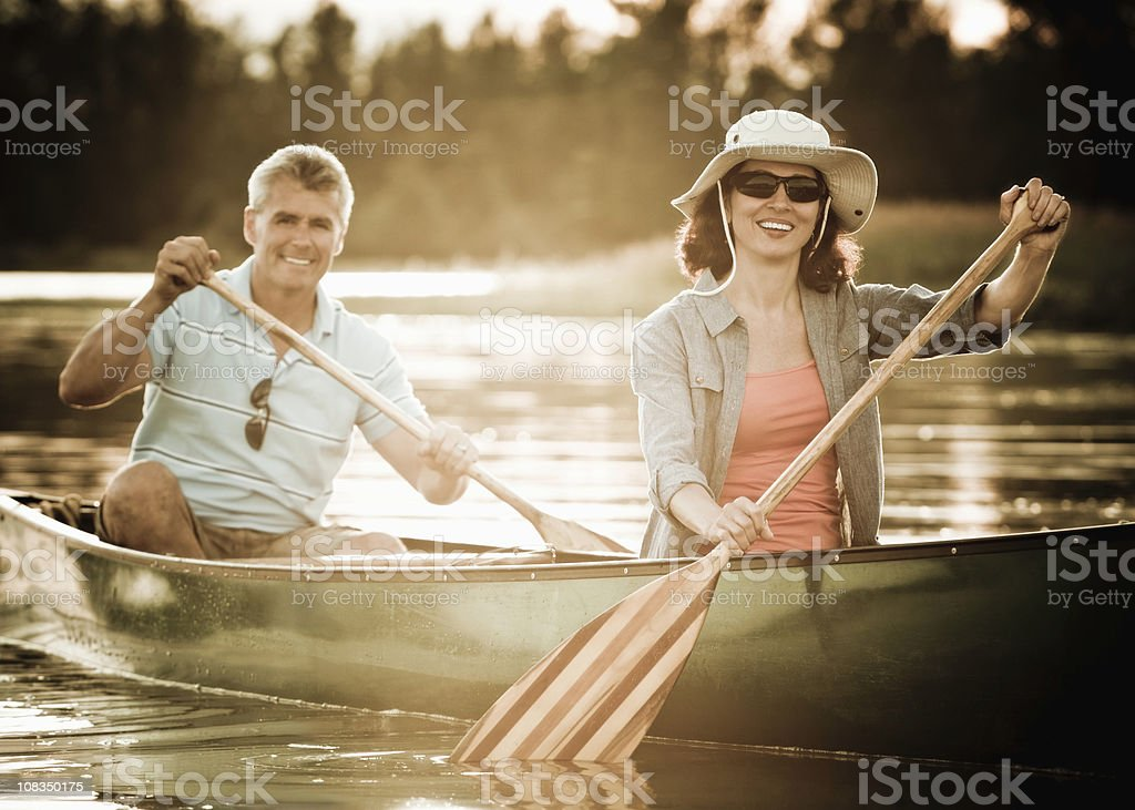 Mature Couple in a Canoe stock photo