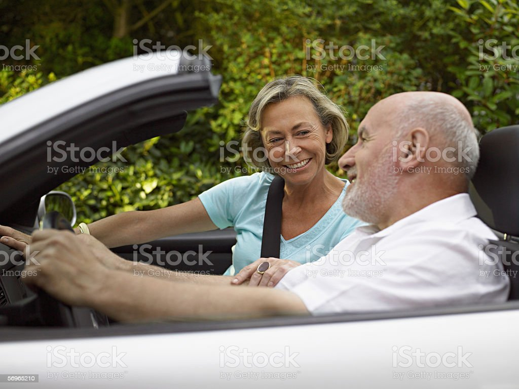 Mature couple in a convertible stock photo