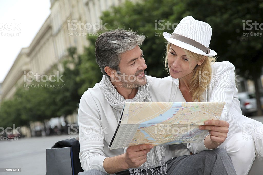 Mature couple in a tourisitc city royalty-free stock photo
