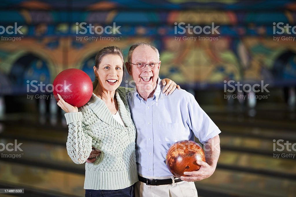 Mature couple in bowling alley stock photo