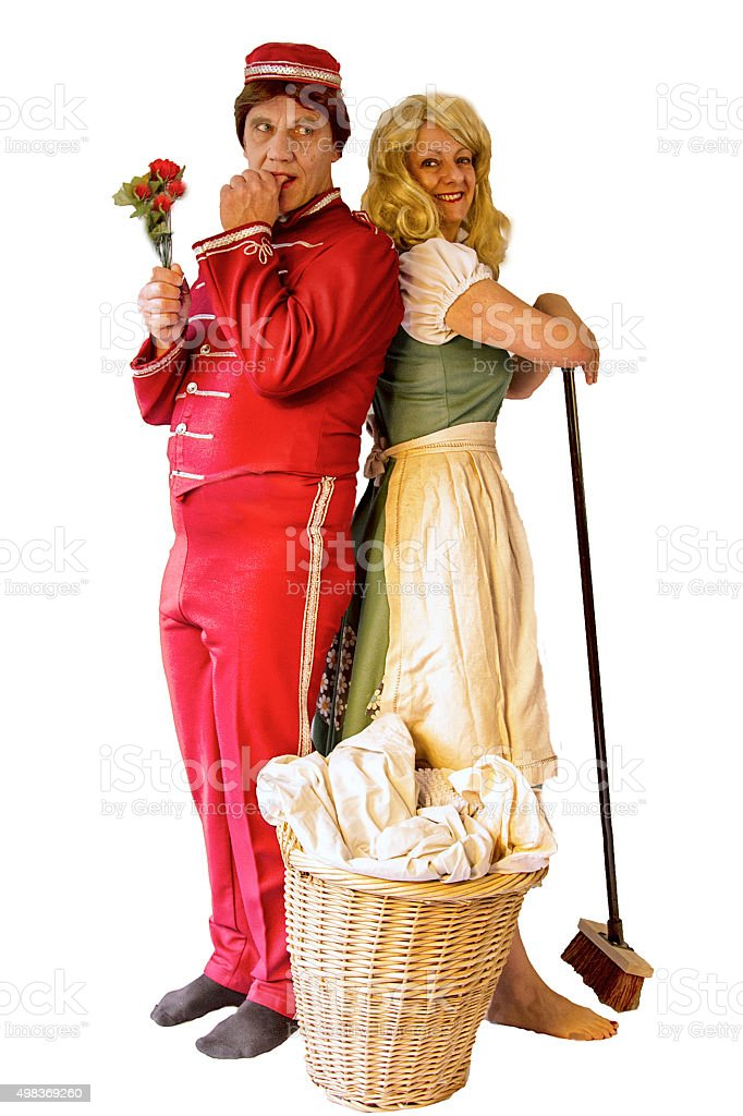 Mature couple in costume standing back to back stock photo
