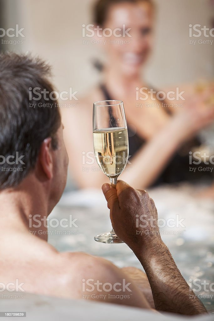 Mature couple in jacuzzi with champagne royalty-free stock photo