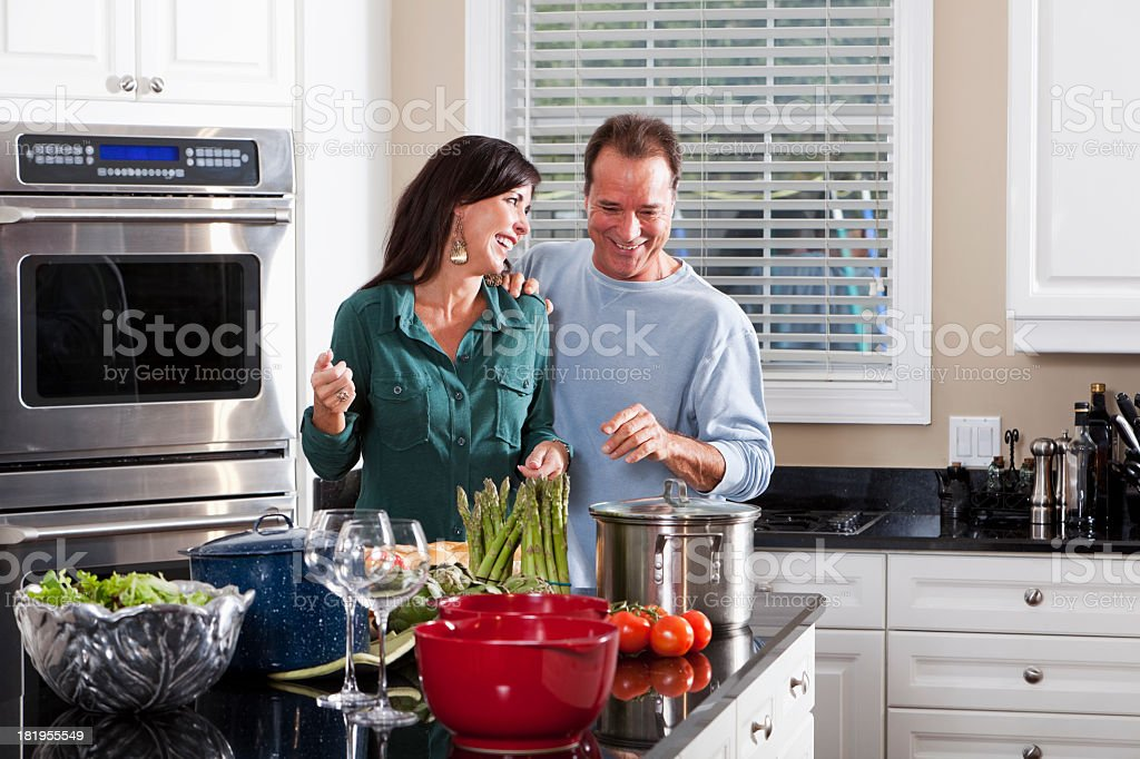 Mature couple in kitchen royalty-free stock photo
