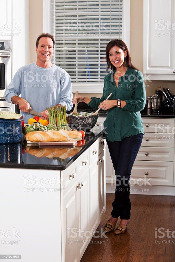 Mature couple in kitchen stock photo