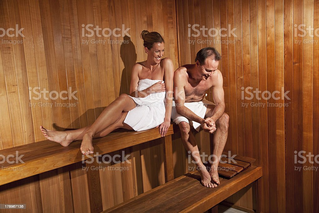 Mature couple in sauna royalty-free stock photo