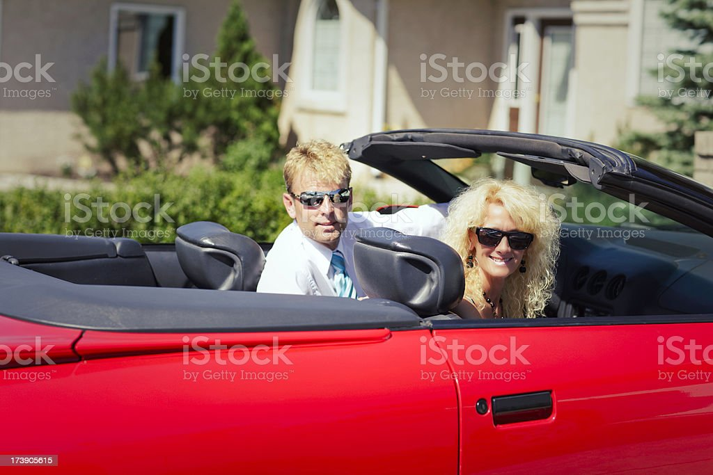 Mature couple in sports car royalty-free stock photo