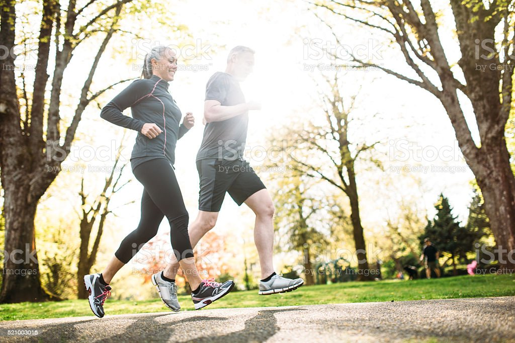 Mature Couple Jogging Outdoors stock photo