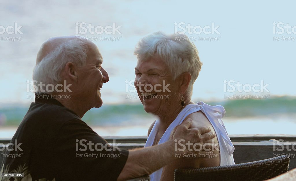 Mature Couple Laughing with Each Other stock photo