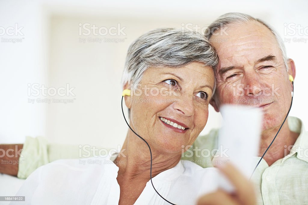 Mature couple listening to music together royalty-free stock photo
