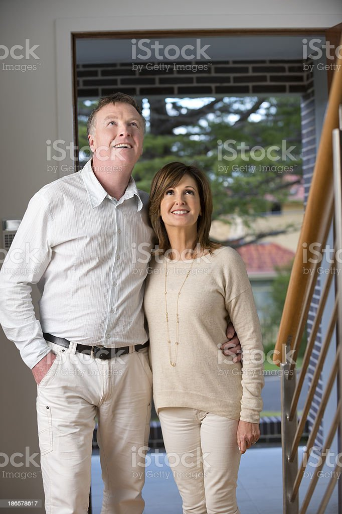 Mature couple looking around a new house royalty-free stock photo