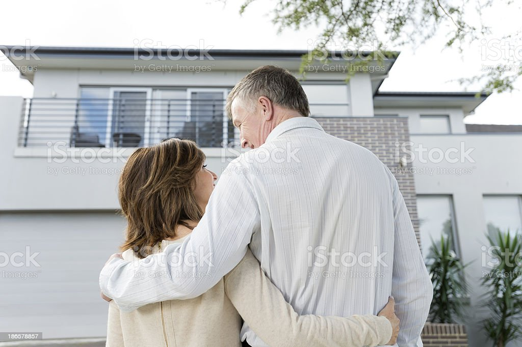 Mature couple looking at a house royalty-free stock photo