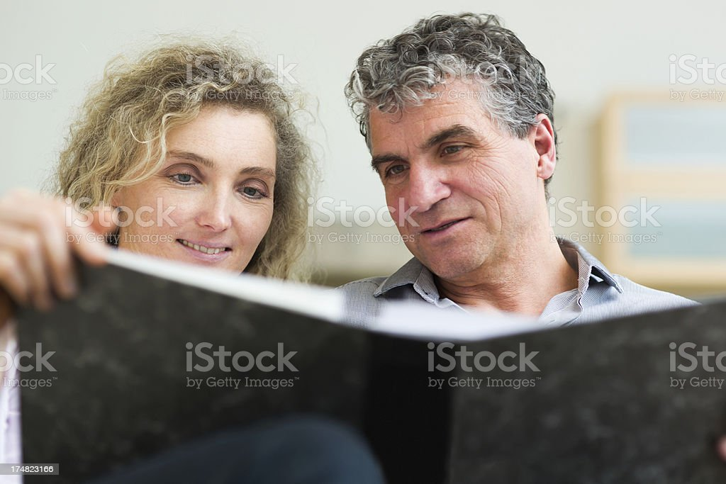 Mature couple looking at old photos royalty-free stock photo