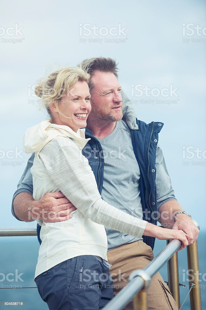 Mature couple looking at view. stock photo