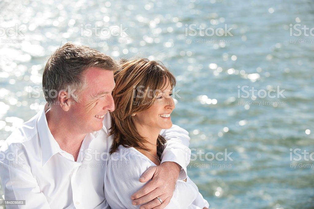 Mature couple looking away stock photo