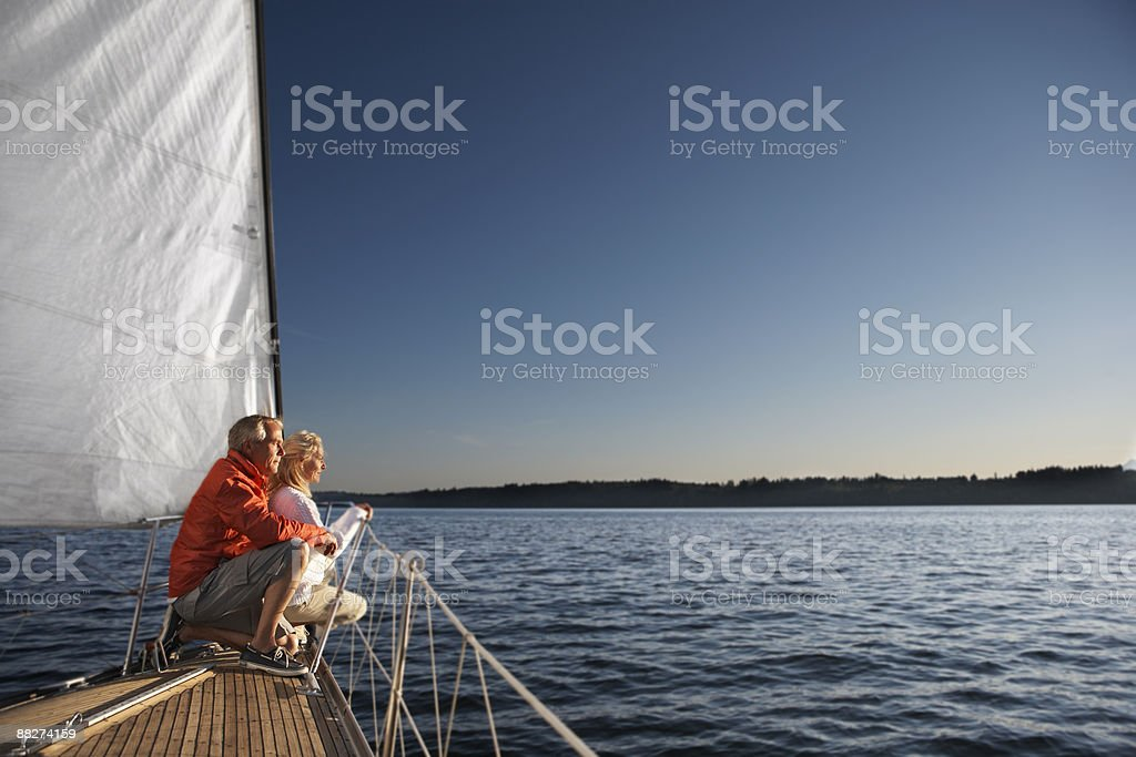 Mature couple looking out to horizon stock photo