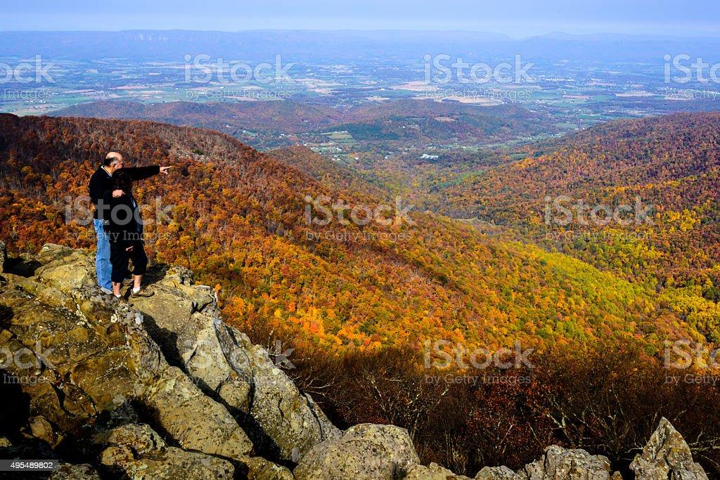 XXXL: Mature couple looking over an autumn scene stock photo