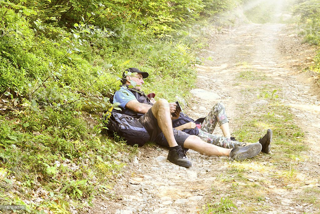 Mature Couple Looking Tablet in a Forest royalty-free stock photo