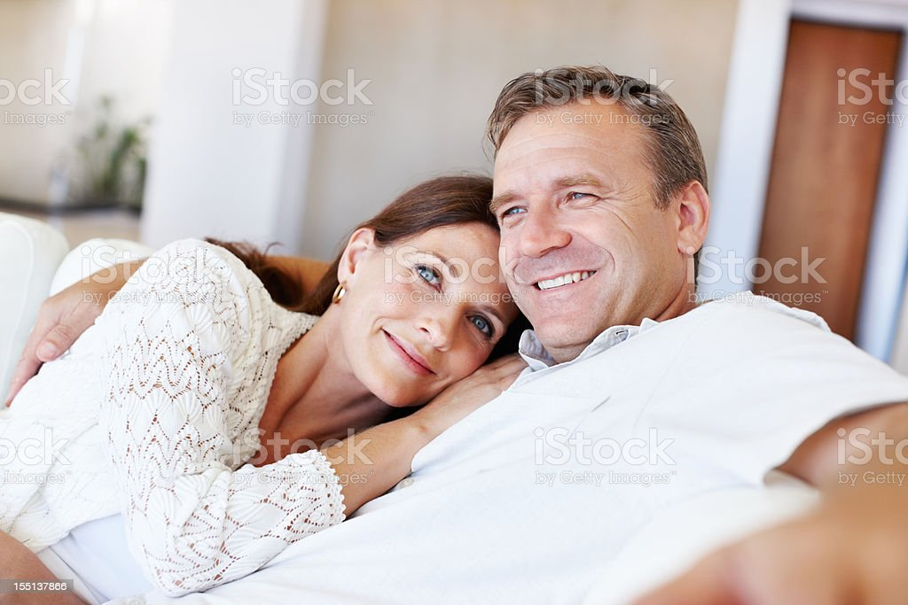 Mature couple lounging in couch royalty-free stock photo