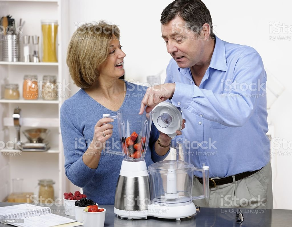 Mature Couple Making Healthy Drink/ Dessert Together royalty-free stock photo