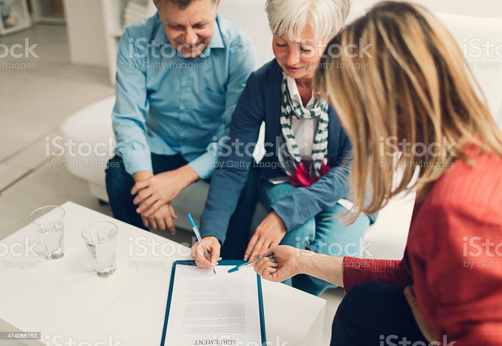 Mature Couple Meeting with Financial Advisor. stock photo