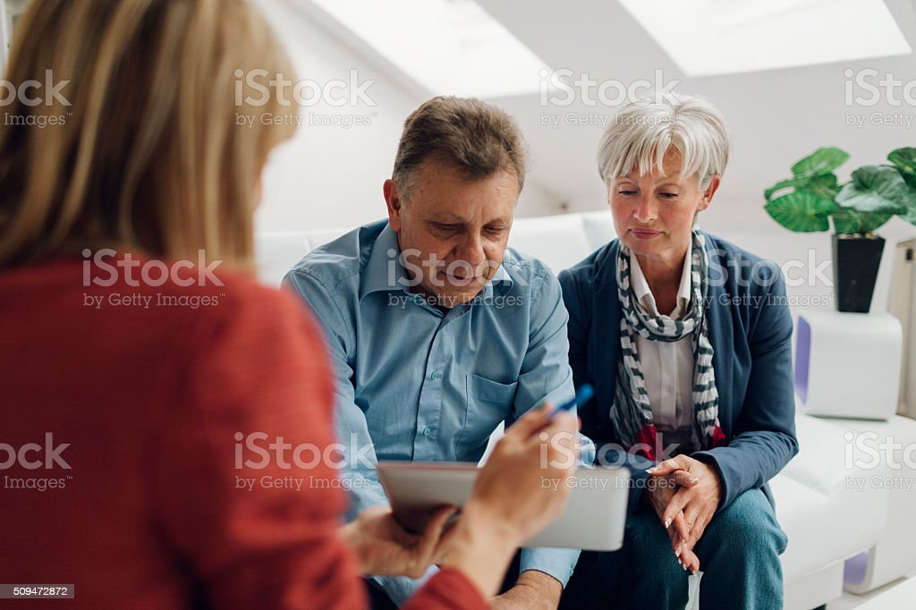 Mature Couple Meeting with Financial Advisor stock photo
