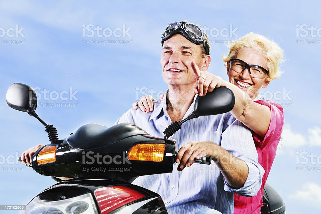 Mature couple on a motorbike royalty-free stock photo