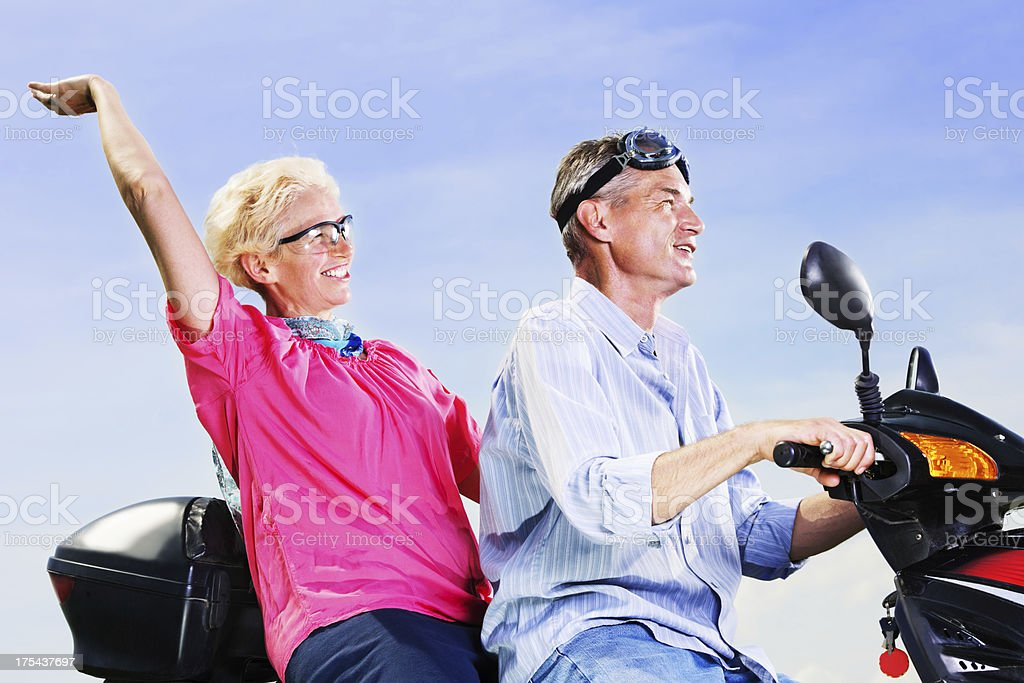 Mature couple on a motorbike. royalty-free stock photo