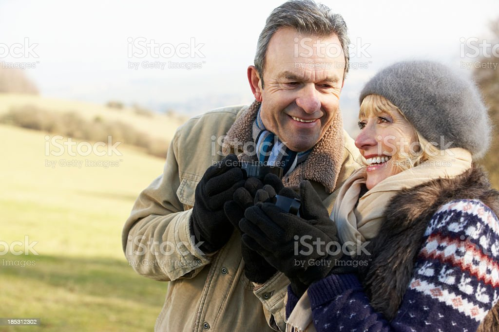 Mature couple on country picnic in winter royalty-free stock photo