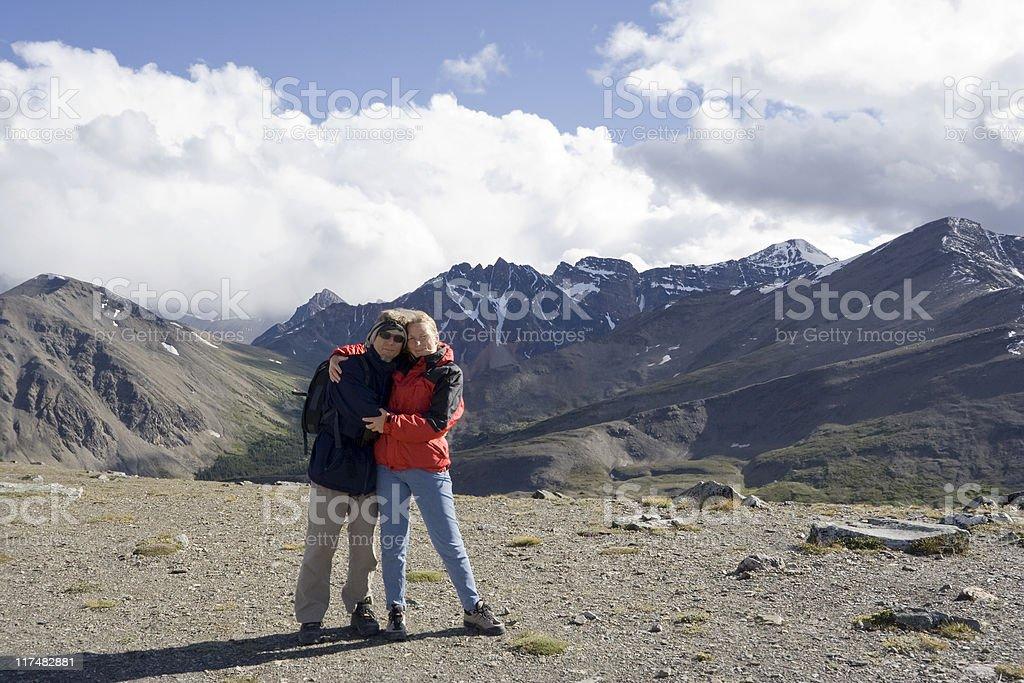 mature couple on mountain peak royalty-free stock photo