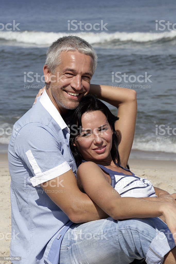 Mature couple on the beach royalty-free stock photo
