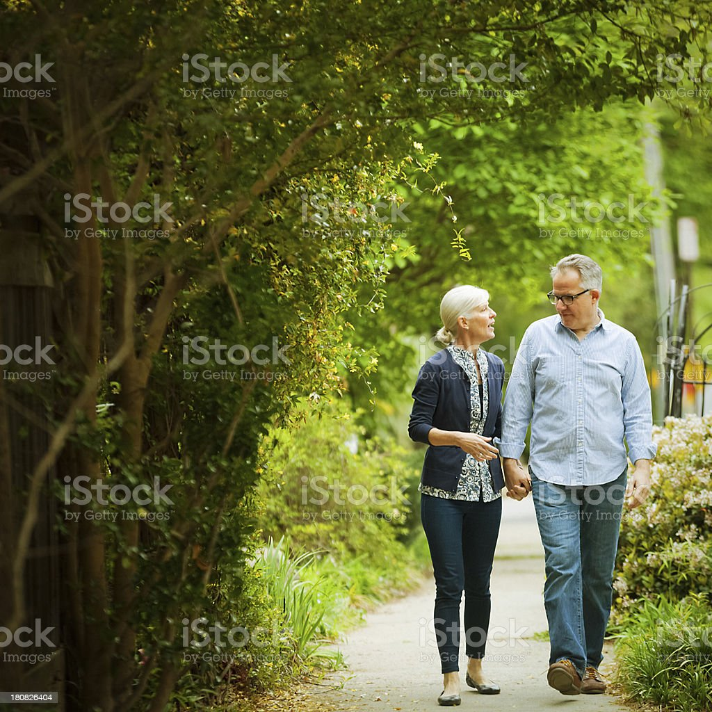 mature couple out for a walk royalty-free stock photo