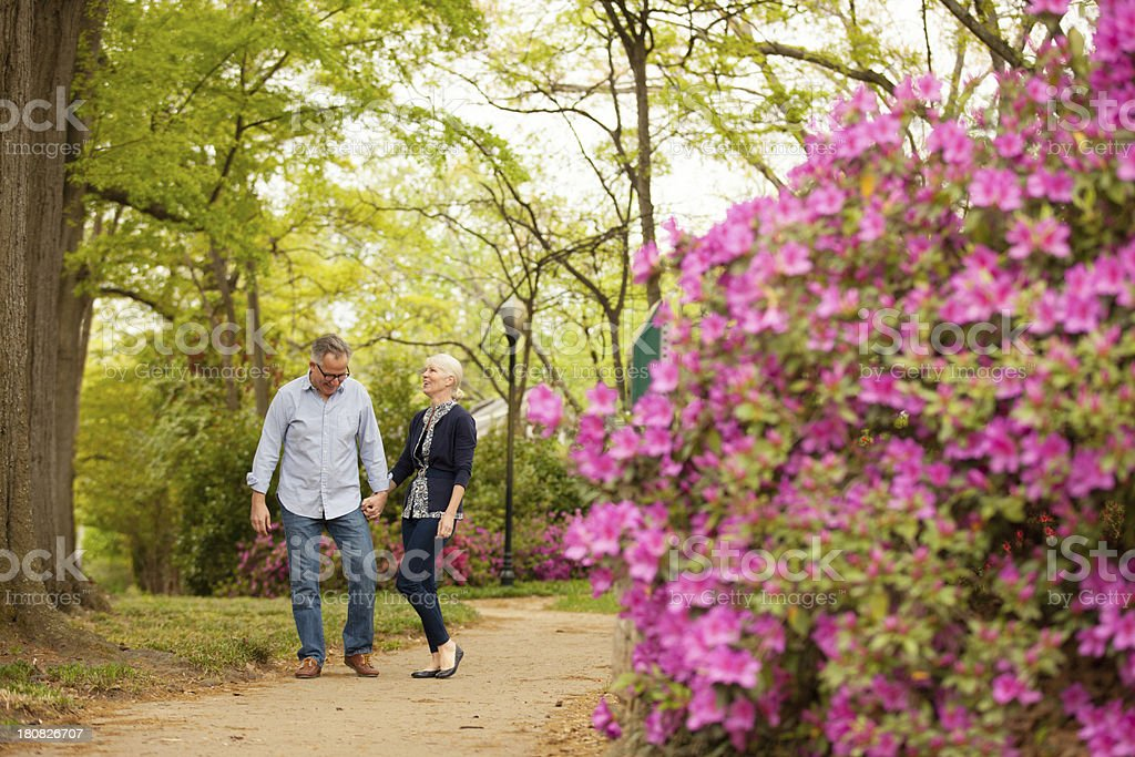 mature couple out walking in the park royalty-free stock photo