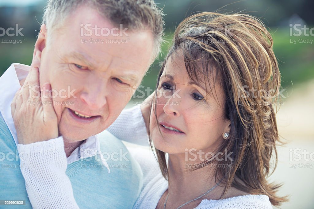 Mature couple outdoors grieving and upset stock photo