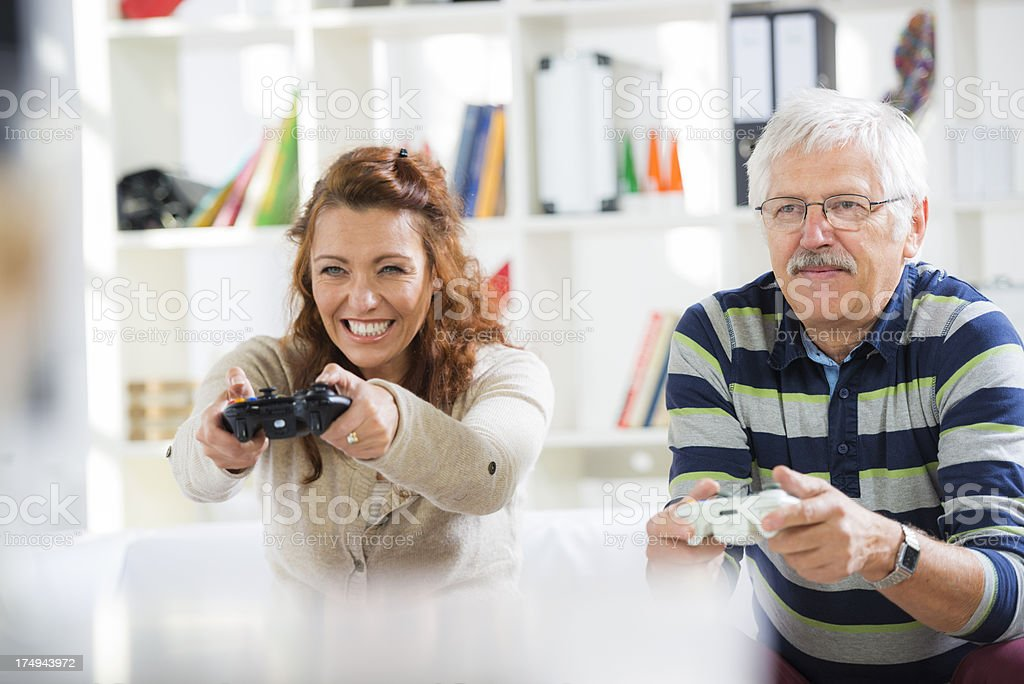 Mature Couple Playing Video Games royalty-free stock photo