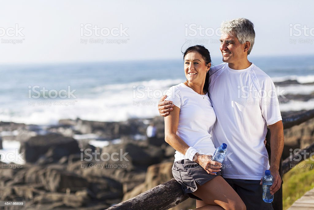 mature couple relaxing after exercise royalty-free stock photo