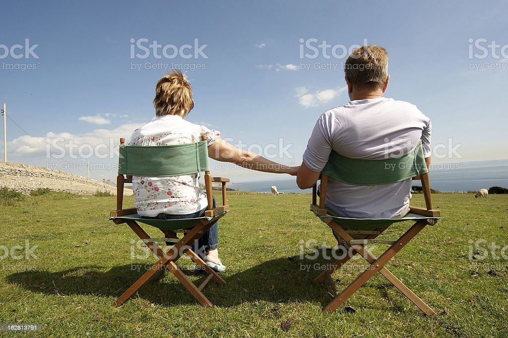 Mature couple relaxing at the coast royalty-free stock photo