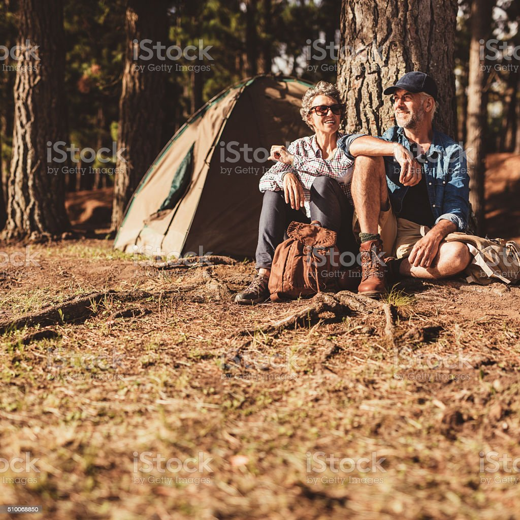 Mature couple relaxing at their campsite stock photo