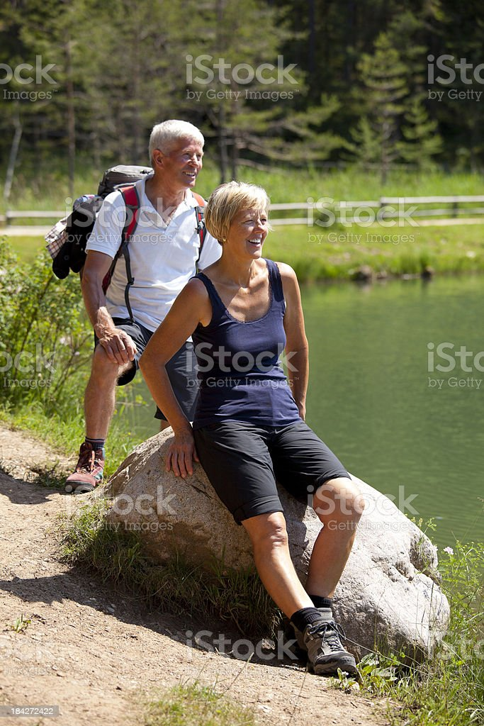 Mature couple relaxing on lake royalty-free stock photo
