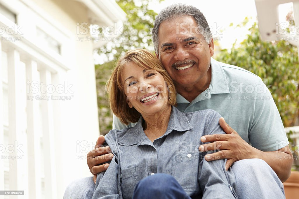 Mature couple relaxing outdoors stock photo