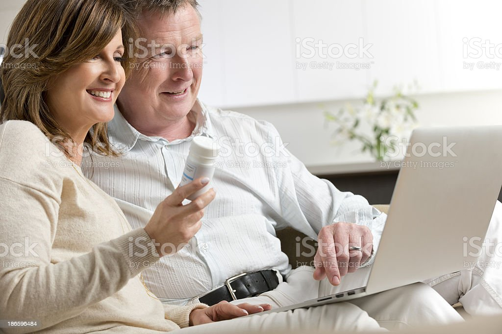 Mature couple researching medicine on the internet royalty-free stock photo